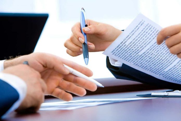 Corporate Branding and Marketing signing documents